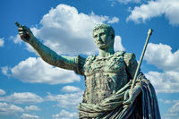 The roman emperor Gaius Julius Caesar statue in Rome, Italy. Concept for authority, domination, leadership and guidance.
