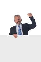 Mature businessman holding white panel