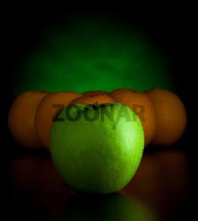 oranges and apple like billiard balls