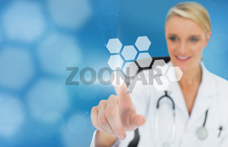Blonde doctor using touchscreen displaying hologram