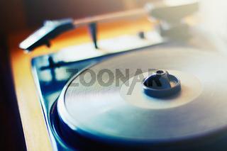 Retro record player, air-bearing turntable closeup, soft focus