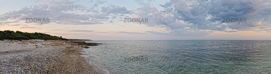 Sunset landscape with coast of the sea. Panorama.