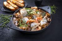 Modern style traditional Spanish seafood zarzuela de pescado with fish