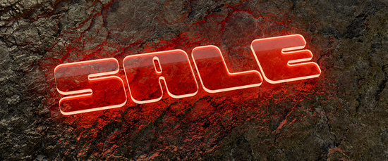 glowing sale sign on a wet rock surface
