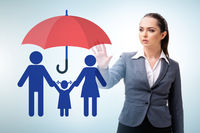 Life insurance concept with businesswoman pressing button