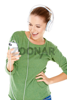 Woman laughing as she enjoys her music