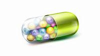 Big green pill with vitamins balls inside