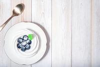 Top view on healthy vegan dessert anna pavlova on white wooden table