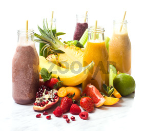The delicious smoothies with exotic fruits on a white background