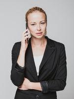 Beautiful young caucasian businesswoman using mobile phone.