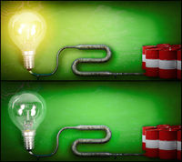 Lightbulb and gasoline barrels