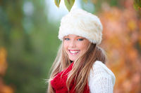 happy smiling autumn woman with fur hat