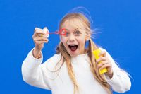 Funny girl blowing soap bubbles