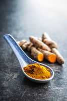 Indian turmeric powder and root. Turmeric spice. Ground turmeric
