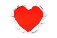 Ripped paper hole heart on white