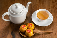High angle view of sweet chinese pastry or moon cake and a cup of tea.