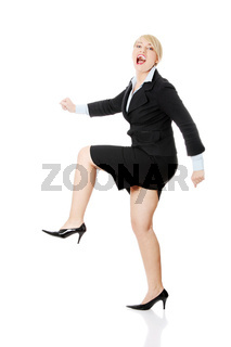 Middleaged businesswoman running