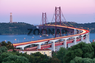 Lisbon 25 de Abril bridge and Jesus Christ statue Cristo Rei at sunset, best view of Lisbon, in Portugal