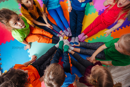 Top view circle of young kids in colorful clothes