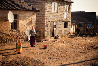 SEREDNIE, UKRAINE - MARCH 09, 2011: Kids growing in poverty with limited access to education