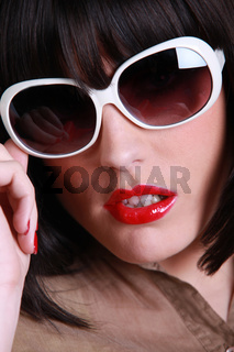 close up of brunette wearing sunglasses