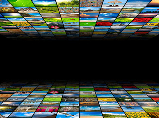 Abstract multimedia background composed of many images with copyspace in the center