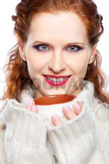 Beautiful girl in a cashmere sweater with cup of hot chocolate or coffee or tea