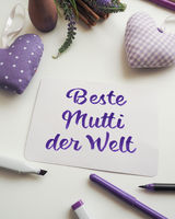 German Best mom of the world as brush lettering on a mother's day greeting card
