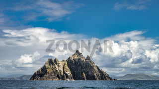 Cruise boat in front of Little Skellig island, with Irish coastline in the background
