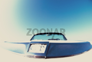 above the hood of classic american convertible 60's dodge dart with fish eye