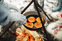 Pot with mulled wine over fire