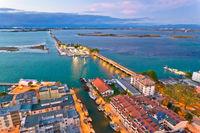 Town of Grado archipelago and bridge to mainland aerial evening view