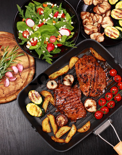 Beef steak with grilled vegetable and mushrooms