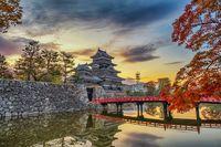 Matsumoto Nagano Japan, sunrise city skyline at Matsumoto Castle with autumn foliage season