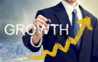 Businessman writing Growth