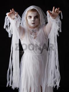 Girl in Halloween ghost costume