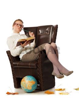 female teacher sitting in armchair