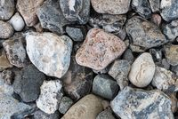top view of pebbles or stones on beach