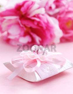 Pink present box with pacifier for baby girl