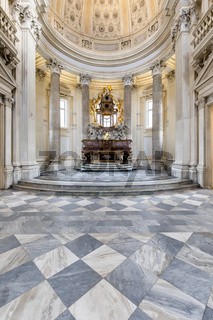 Sacred catholic altar in Baroque style and cupola. Day light - Italy
