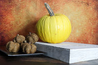 A yellow and twine pumkins against a orange background