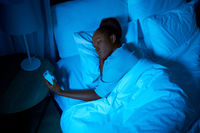 woman awaking because of alarm clock at night