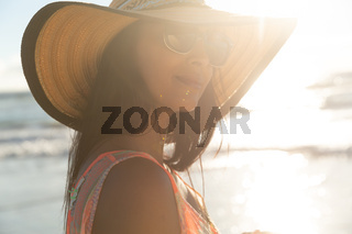 Portrait of smiling mixed race woman on beach holiday