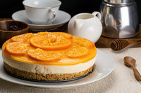 Side view of delicious homemade orange cheesecake.
