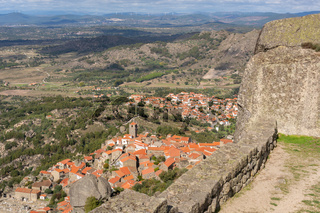 Monsanto historic village with stone boulder buildings and rooftops seen from the castle, in Portugal