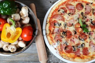 The Italian pizza with a ham and mushrooms
