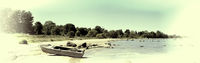 Boat on the beach of bay. Vintage