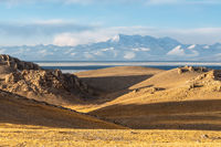 tibet plateau landscape of holy lake and snow mountain