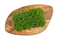 Green arugula microgreen on wooden cutting board