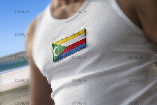 The national flag of Comoros on the athlete's chest